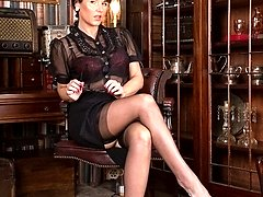 Raven likes to crack the whip at work in her black stockings and multi-strap garter...