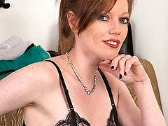 Redhead Holly, teases and dildo pleases in black nylon slip, sheer panties and French nylons!