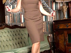 Sophia, looking hot in vintage garters, sheer glossy nylons and high heels for a pussy...