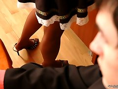 Pantyhosed maid ready to give guy her sexy shoe to lick before hot footjob