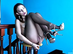 Sexy babe goes for solo anal play showcasing feet in tights and high heels