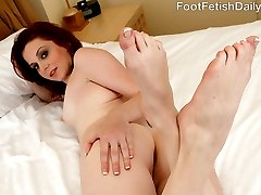 Emma is ready to give her man a footjob like he has never had. She strokes is hard cock back and...