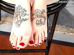 Bobbi Dylan is trying to get her man's attention. She put on some sexy heels, and is walking around for him. Finally she puts her foot down... on him. He gets so turned on that he has to worship her feet. She gives he a footjob then fucks him all ways until his load spills all over her feet