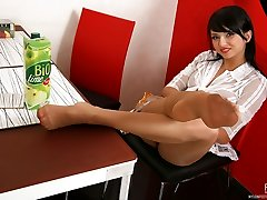 Frisky chick teases with her nylon covered feet treating them to fresh milk