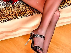 Cutie throwing off high heel sandals and posing in her reinforced toes hose