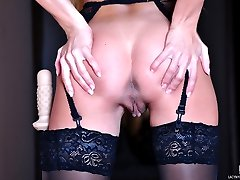 Long-haired redhead strips her LBD and rides her dildo in black stockings