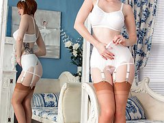 Zara peels off to display white classic lingerie and FF nylons that almost match her hair!