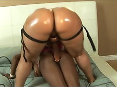 Pink haired lesbian strapon fucks a black friend