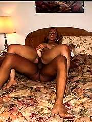 Ebony babe fucked with a dildo and a dick at the same time