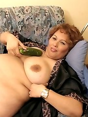 Horny desperate huge size lady playing with cucumber