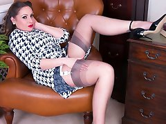 Sophia's passion for high heels, exquisite fully fashioned nylons and top lingerie makes the lucky assistants tasks a pleasant one!