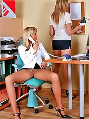 Naughty upskirt secretaries in control top hose show their nyloned pussies