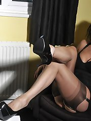 Hot Milf Nylon Jane shows off her curves in her sexy nylon stockings, black lingerie and...