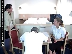 Guy bent over with his pants down and brutally caned by two strict young bitches