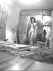 Bedroom hidden cam has caught a naked babe