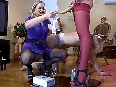 Two freaky chicks use gloved fingers and a strapon to team fuck a sissy guy