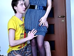 Strapon-armed gal lets her cock-loving boy lick and ass ride her rubber toy