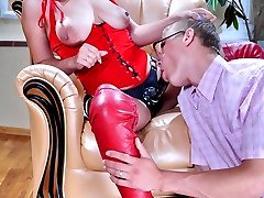 Red hot domina pushes her black strapon into a mouth and ass of a nerdy boy