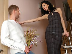 Dressed up babe seduces a next-door guy pushing her strap-on into his rear