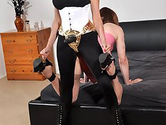 Strapon Jane bends over a horny TGirl slut and plays with her sexy ass.