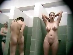 Natural bustybeauties caught on hidden shower cams while soaping their assets