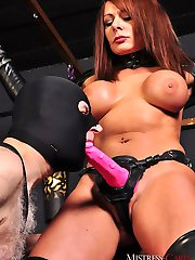 Mistress Carly makes her gimp slave suck and gag on her big pink strapon! Then she attaches a...