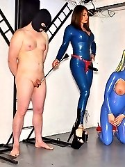Mistress Carly fucks her gimp and latex sex doll with her big black strapon, then instructs her doll to take a real cock