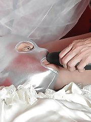 Strapon Jane has this blushing sissy bride exactly where she wants him! On her bed gagging for her big black strapon