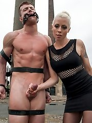Our eastern European expeditions continue with Mistress Lorelei Lee at an old meat factory in the countryside of the Czech Republic where Fetish Liza, part of our European Divine Bitch sector, has left one lucky euro slave boy naked and bound in the cold for Lorelei to test out. These men have never had women like Mistress Lorelei Lee, a true California beauty, tease their cocks before and their cocks don\'t lie! With every slash of the whip Ivo just gets harder and harder until he\'s drooling all over himself. He\'s made to worship her fine ass in pantyhose and gets strap-on ass fucked and his cock is still hard as a rock! At some point Lorelei decides she must put him through the ultimate challenge and she mummifies him on the train tracks with only his cock and his mouth stuffed with a dildo gag exposed. She rides that dildo on his face so close that he can smell the sex emanating from her delicious cunt. His dick is throbbing at this point but unlucky for him and much to Lorelei\'s enjoyment the train is coming and either he cums or he is left bound on the tracks for the ultimate denial!