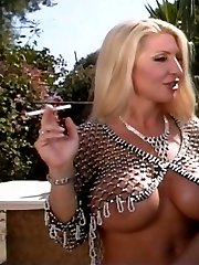 Busty lesbian mistress and her sexy submissive playing with food outdoors