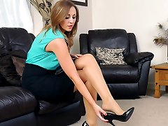 Girl next door Debbie puts on a sexy home tease just for you wearing her silky nylons and shiny tall black stilettos