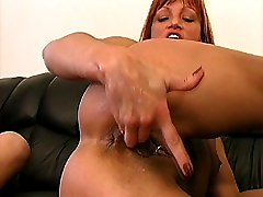 She stuffs her hand into her twat