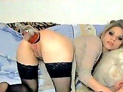 Hot little blond teen destroys her ass with a giant dildo