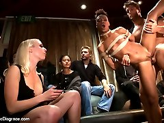 Tight bodied, Nikki Darling, is bound and gagged, fucked, footed, and fisted on stage in a divey...