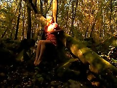 This nubile teen has some very kinky fantasies. Here she has her lover tie her to this tree and...
