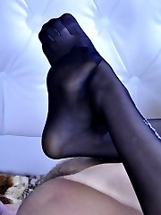 Hot chick gets her feet in expensive tights sprayed with cum after foot sex