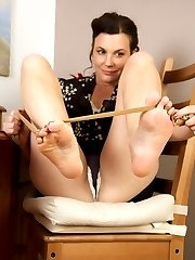 Sofia peels off her thigh highs to get her naked feet into action.