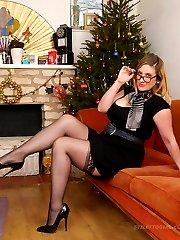 Heidi is in her full festive fetish around the Christmas tree in her lovely black dress, silky...