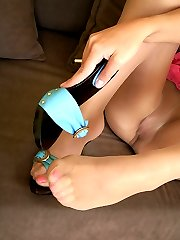 Misbehaving girlie in blue sandals and lacy tights showing her yummy feet