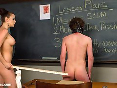 Schools in and Chanel Preston gives lesson plans from classic literature, SCUM by Valarie Solanas. If you don't know this book, go out, buy and read it. In the meantime, slave boys, take your cues from Mistress Preston and learn your place in this world. Below her beautiful feet is where you belong, getting trampled by her heels is your privilege! Start admitting you like it in the ass and make a change in this world. Get comfortable with the demise of your maleness and lick pussy. Lots of it. Understand the privilege and do it well, slaves!