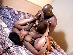 Ebony chick sucking her nipples and getting fucked by a bald thug