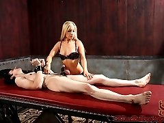 Ashley Fires has kades hands bound to his cock and balls, while sitting on his face and getting...