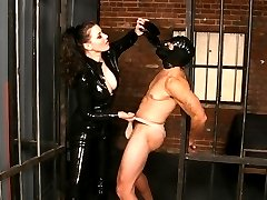 Sexy mistress Anastasia Pierce punishes her male submissive partner with painful duck tape...