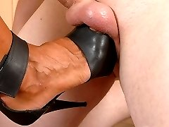Swarthy mature lady steps down onto her boy toys vulnerable shaven balls