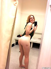Amateur blonde girl use her camera to take pictures of her nasty big butt in front of mirror