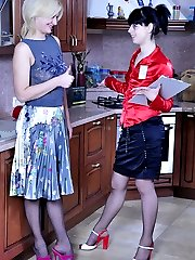 Brunette and blonde in black tights playing slits and clits in the kitchen
