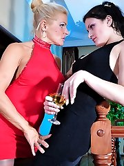 Hot chick drinks champagne while getting her muff eaten by a hungry lesbo