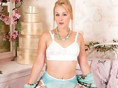 Pretty blonde Aston loves the look and feel of her seductive outfit, those panties, her stunning gown and glossy sheer RHT nylons!