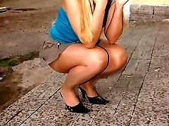 Blonde shows her pantyhose upskirt on city streets