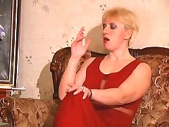Smoking mature gal is ready to try out a new strap-on with a next-door girl